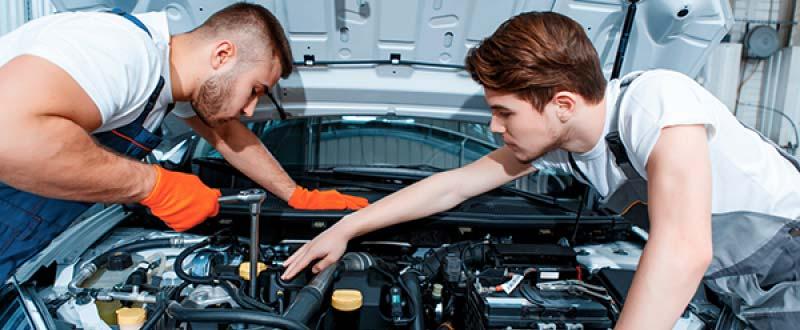 Mechanics Servicing A Car